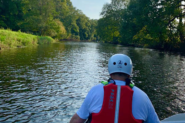 man in canoe on river